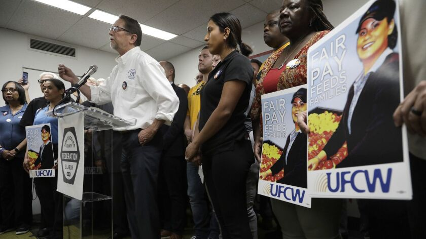 LOS ANGELES, CA -- JULY 01, 2019: John Grant, president of UFCW 770, stands with members of UFCW and