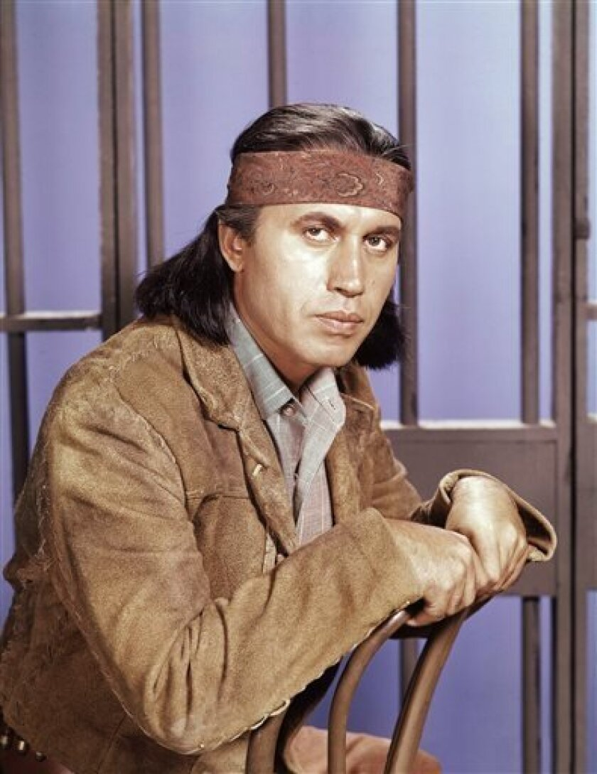 """FILE - This 1960 photo shows actor Michael Ansara on location for the TV series, """"Law of the Plainsman."""" A longtime friend and spokesman for Ansara says the actor died Wednesday, July 31, 2013, at his home in California after a long illness. He was 91. (AP Photo, File)"""