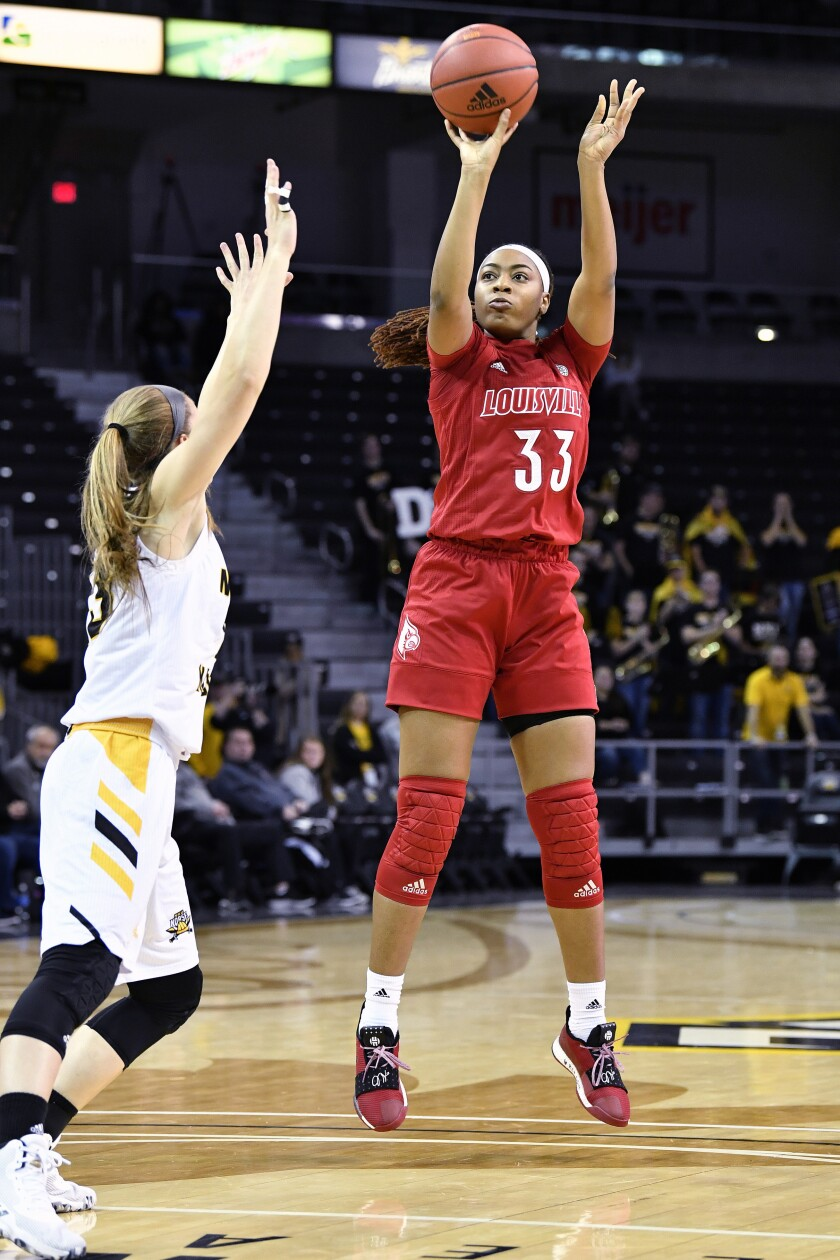 Louisville forward Bionca Dunham (33) shoots over the defense of Northern Kentucky forward Kailey Coffey (23) during the first half of an NCAA college basketball game in Highland Heights, Ky., Sunday, Dec. 8, 2019. (AP Photo/Timothy D. Easley)