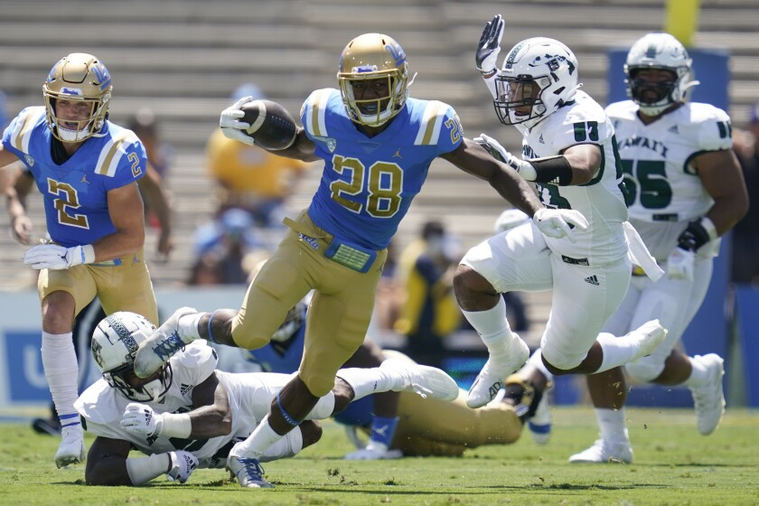UCLA Bruins running back Brittain Brown (28) runs the ball during the first half of an NCAA college football game against the Hawaii Warriors Saturday, Aug. 28, 2021, in Pasadena, Calif. (AP Photo/Ashley Landis)