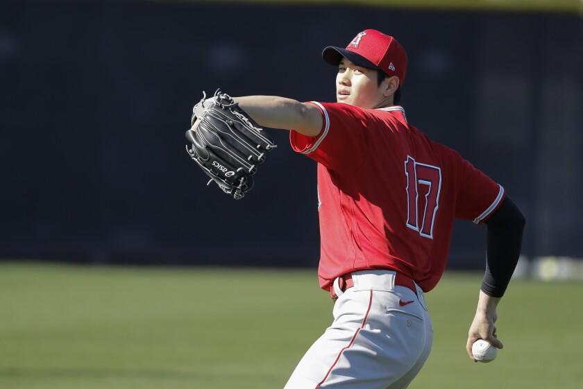 Los Angeles Angels' Shohei Ohtani throws during spring training baseball practice, Wednesday, Feb. 12, 2020, in Tempe, Ariz. (AP Photo/Darron Cummings)