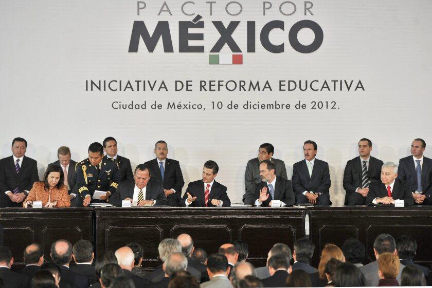Mexican President Enrique Peña Nieto, center, at the announcement of an education reform plan.