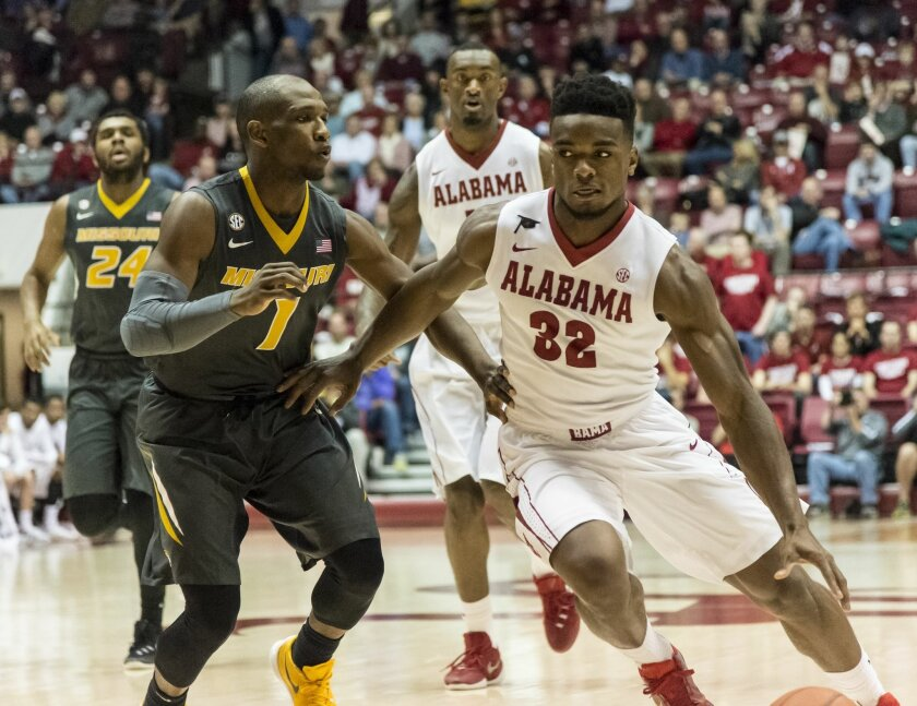 Alabama guard Retin Obasohan (32) battles with Missouri guard Terrence Phillips (1) to get a position for a shot during an NCAA college basketball game, Saturday, Feb. 6, 2016, in Tuscaloosa, Ala. (Vasha Hunt /AL.com via AP) MAGS OUT; MANDATORY CREDIT