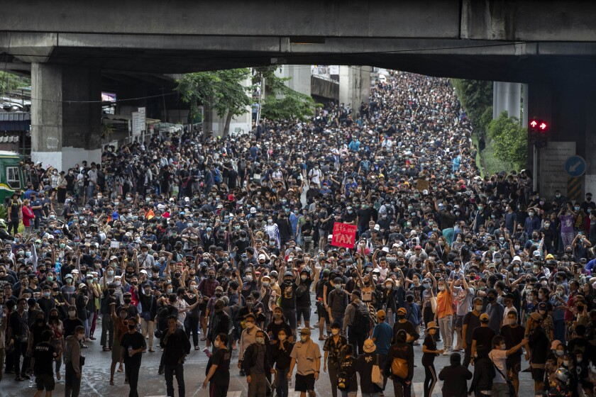 Pro-democracy protesters march during a protest in Udom Suk, suburbs of Bangkok, Thailand