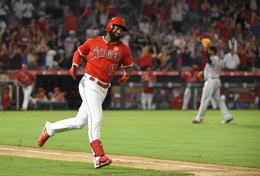 Angels' Brian Goodwin rounds first after hitting a ninth-inning solo home run.