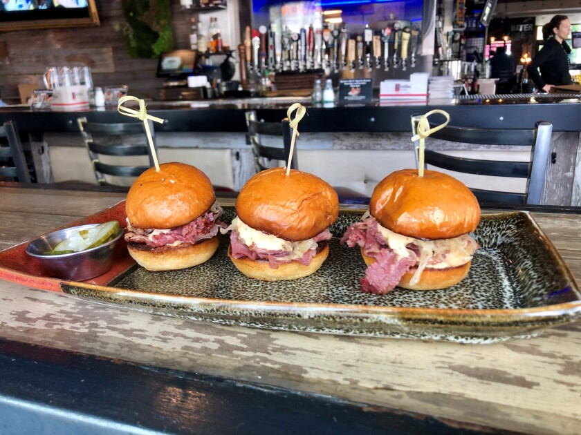Celebrate St. Patrick's Day with corned beef sliders.
