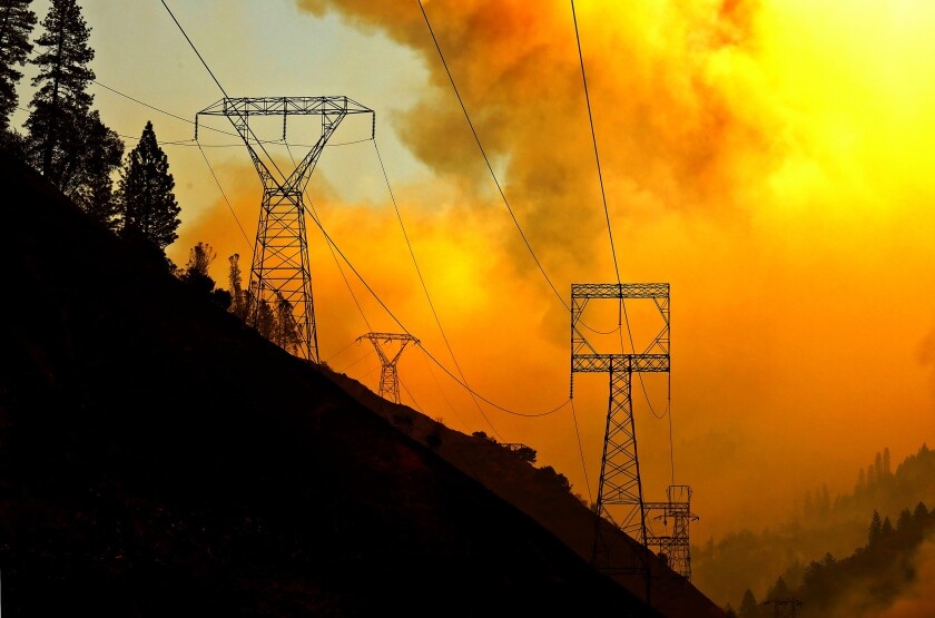 Utility transmission towers near a wildfire
