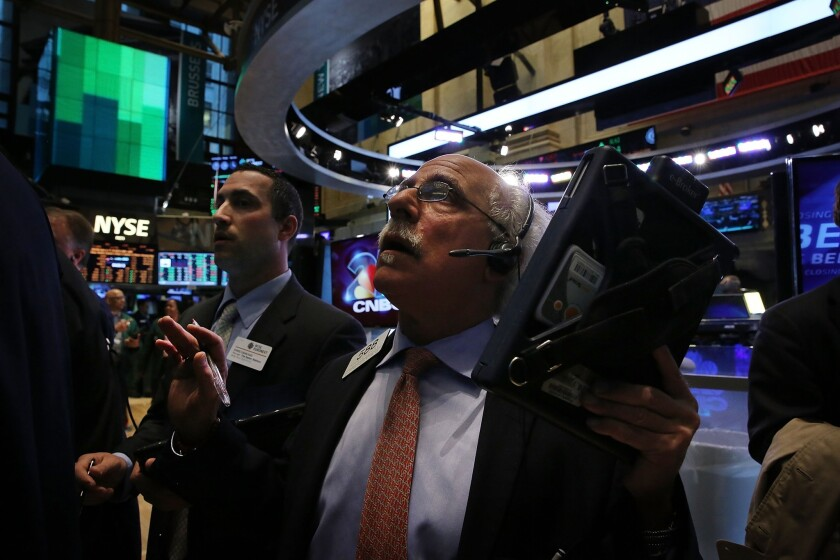 The stock market rose fractionally Monday following its record-setting run last week.