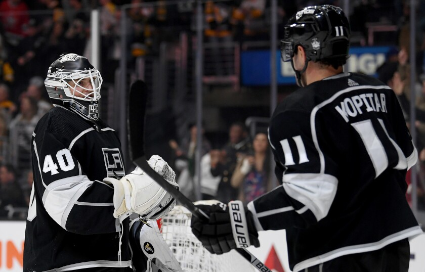 Kings' Calvin Petersen, left, celebrates a 2-1 win over the Pittsburgh Penguins with Anze Kopitar at Staples Center on Wednesday.