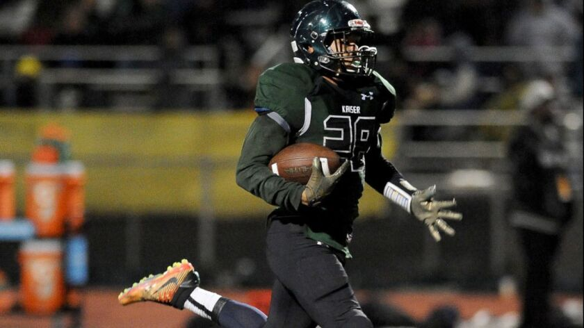 Kaiser running back Christian Hunter breaks into the clear during one of his seven touchdown runs in a CIF regional bowl game two weeks ago,