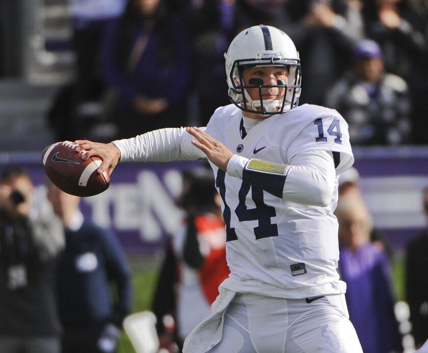 Penn State  quarterback Christian Hackenberg (14) passes during the first quarter of an NCAA college football game against Northwestern in Evanston, Ill.,  Saturday, Nov. 7, 2015. (AP Photo/Matt Marton)