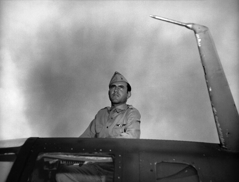 Louis Zamperini, then an Army Air Corps bombardier in World War II, looks out from the hatch of bomber in January 1943.