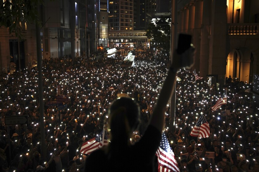 Protesters light torches at a peaceful rally in central Hong Kong on Oct. 14, 2019.