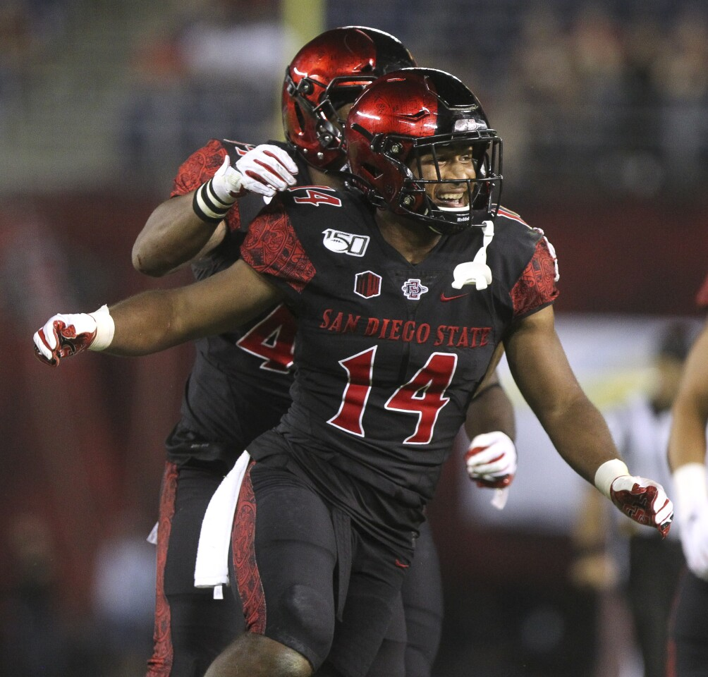 The Aztecs' Tariq Thompson celebrates with teammates after intercepting a pass during the fourth quarter against Weber State at SDCCU Stadium on Saturday, August 31, 2019 in San Diego.