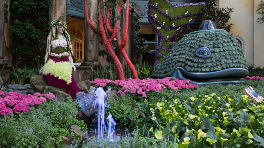 A mermaid and a whale sit beside a coral reef made of pink flowers in this summer's display at the Bellagio's indoor gardens.