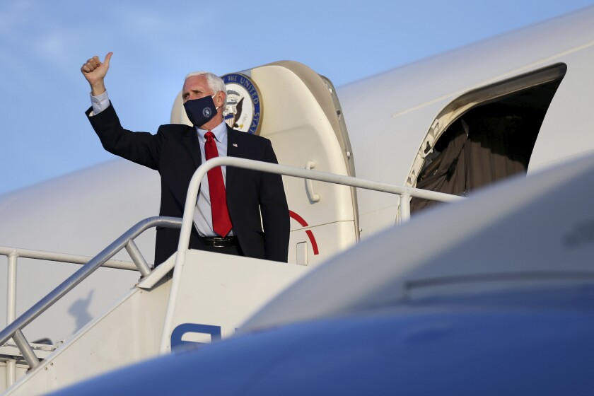 Vice President Mike Pence gives a thumbs-up before departing on Air Force Two from Philadelphia International Airport after a series of stops in Pennsylvania on Thursday, July 9, 2020. (Tim Tai/The Philadelphia Inquirer via AP, Pool)