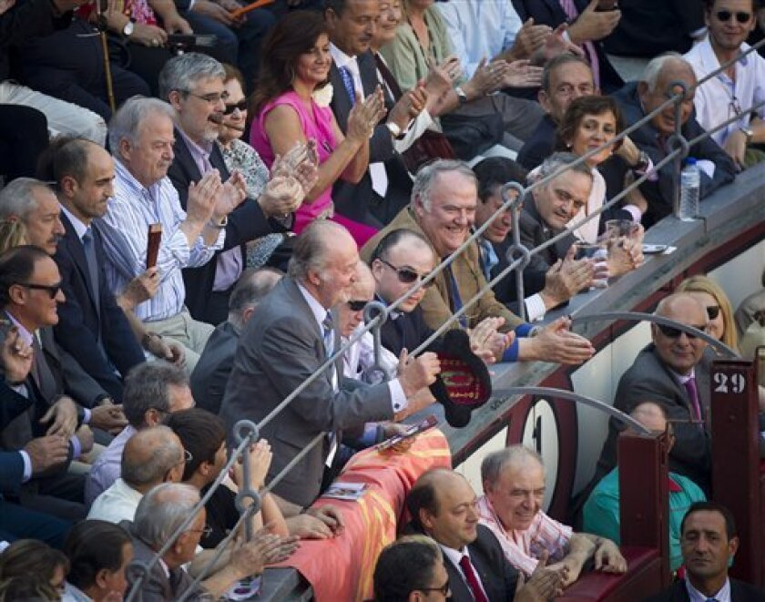 Spanish King Juan Carlos grabs a montera, or bullfighter hat during a bullfight of the San Isidro's fair at the Las Ventas Bullring in Madrid, Wednesday, May 25, 2011. Bullfighting is an ancient tradition in Spain and the season runs from March to October. (AP Photo/Daniel Ochoa de Olza)