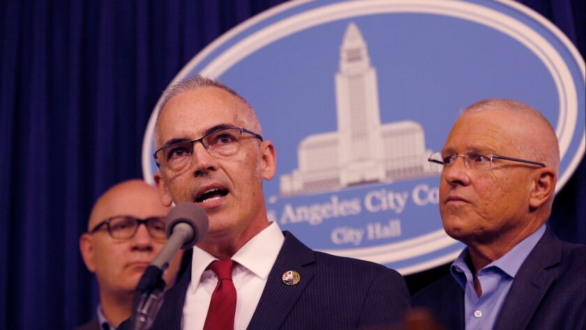 Los Angeles City Councilmen Mitch O'Farrell, center, and Mike Bonin, right, said Tuesday they have been inundated with complaints about higher trash bills and missed refuse pickups under RecycLA, the city's new recycling program.
