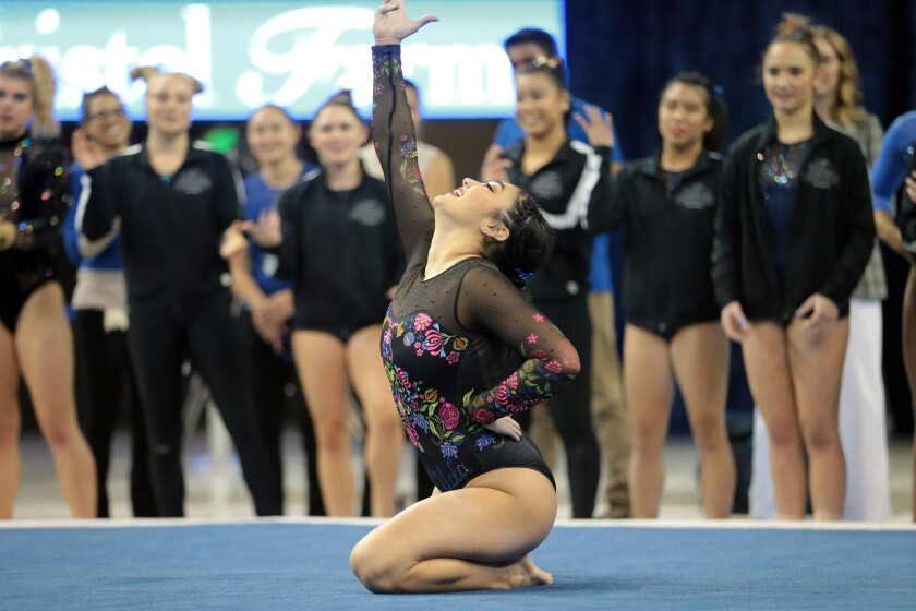 Felicia Hano finishes her floor exercise during the UCLA gymnastics exhibition at Pauley Pavilion on Saturday.