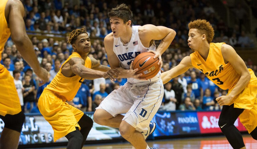 Duke's Grayson Allen, center, handles the ball as Long Beach State's Nick Faust, left, and Long Beach State's Noah Blackwell defend during the second half on Wednesday.