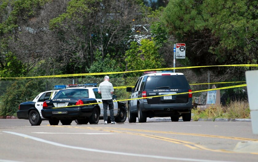 An officer-involved shooting not far from the intersection of Mesa College Drive and Health Center Drive occurred Sunday morning leaving a suspect dead.  An investigator walks near the shooting scene just off the 163 at Mesa College Drive.