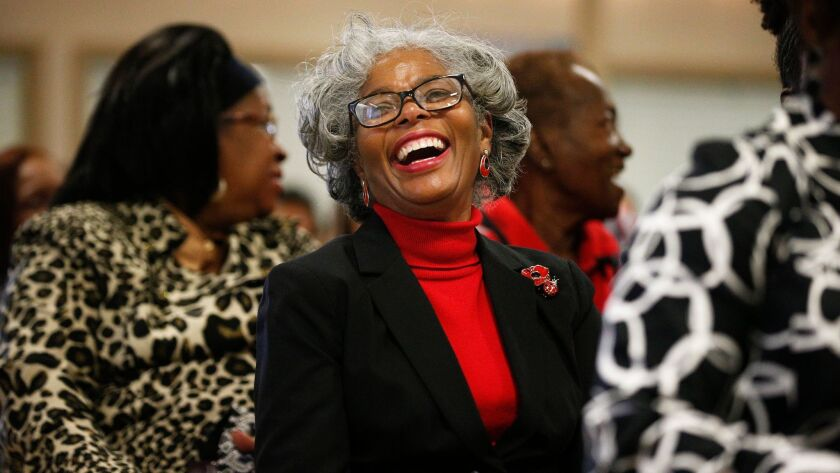 Joyce Holloway laughs during a sermon at a 16th Street Baptist Church service on Dec. 10 in Birmingham, Ala. Pastor Arthur Price told the mostly black congregation that Alabama's U.S. Senate election was too important to skip.