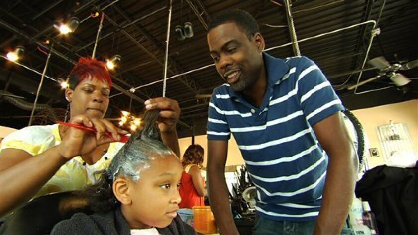 "In this image released by Roadside Attractions, Chris Rock, right, is shown in a scene from, ""Good Hair."" (AP Photo/Roadside Attractions)"