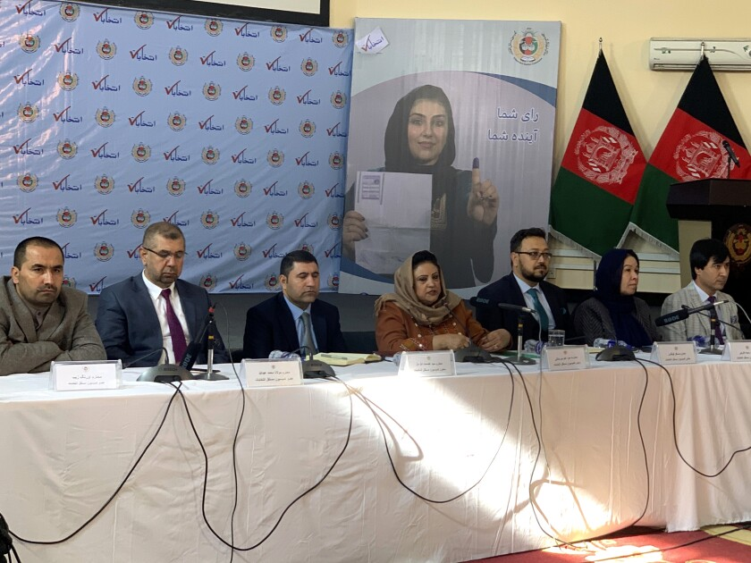 Hawa Alam Nuristani, center, chief of Election Commission of Afghanistan, speaks during a press conference in Kabul, Afghanistan, Sunday, Dec. 22, 2019. The election commission is to announce the results of the Sept. 28 election Sunday. (AP Photo/Rahmat Gul)