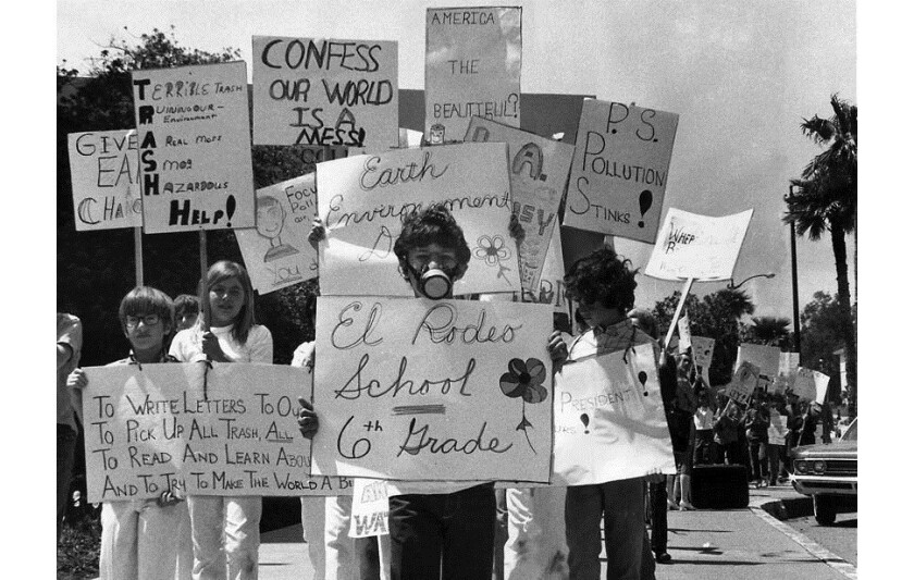 Sixth-grader Brad Frank, 11, wearing a gas mask, joins about 100 classmates during an Earth Day march on Wilshire Boulevard on the first Earth Day, April 22, 1970.