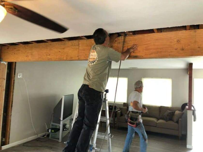 Volunteers work on final renovations for Mahogany House in Oceanside, the newest of Wounded Warrior Homes transitional houses for veterans with post-traumatic stress disorder and traumatic brain injury.