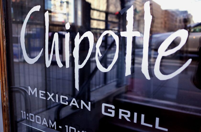 The Chipotle logo is seen on the door of one of its restaurants on January 2015 in Washington, D.C. The chain will close all of its stores for part of the day on Feb. 8 for a national meeting.
