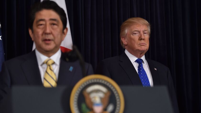 Japanese Prime Minister Shinzo Abe speaks as President Trump listens at Trump's resort in Palm Beach, Fla., on Saturday.