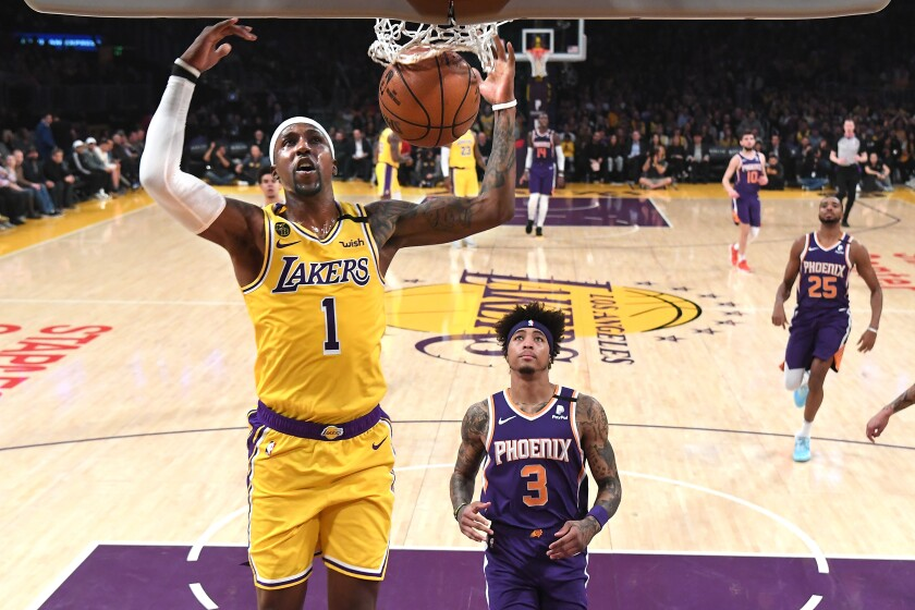 Lakers guard Kentavious Caldwell-Pope dunks against the Suns on Feb. 10, 2020, at Staples Center.