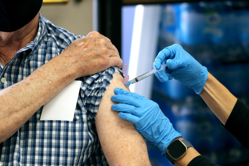 A man gets an injection in his arm