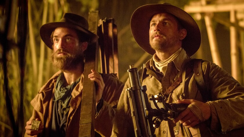 "Robert Pattinson, left, stars as Henry Costin and Charlie Hunnam stars as Percy Fawcett in ""The Lost"