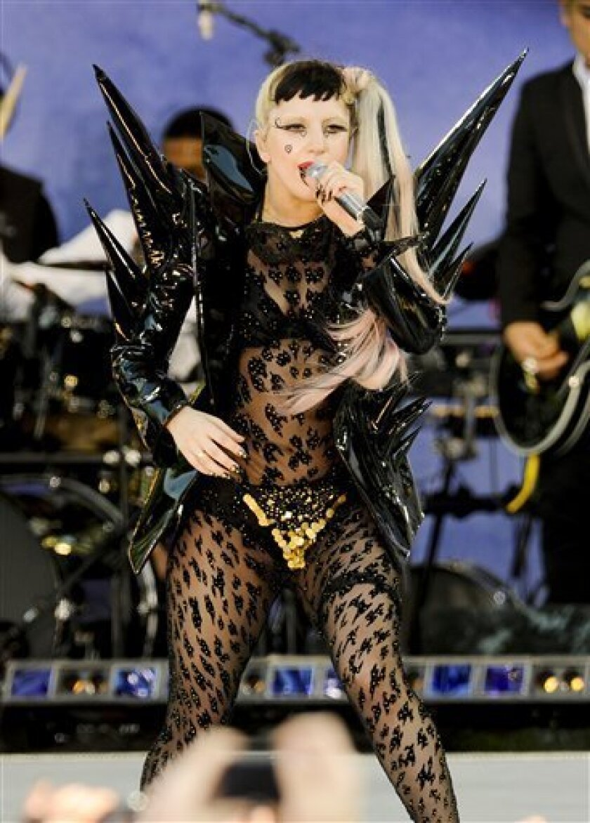 """FILE -- In a May 27, 2011 file photo Lady Gaga performs on ABC's 'Good Morning America' in Central Park in New York. Billboard announced Tuesday, March 31, 2011, that """"Born This Way"""" debuted at No. 1 on its Billboard 200 album chart and the top-selling digital debut. (AP Photo/Evan Agostini/file)"""