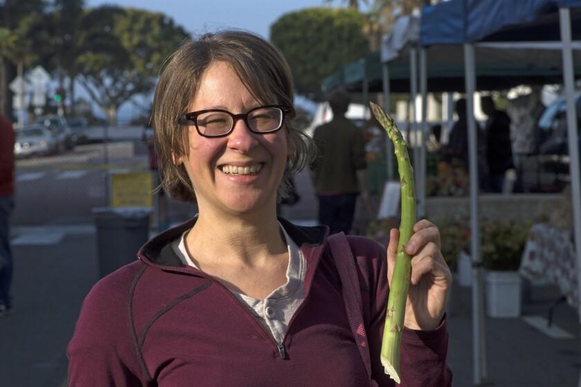 Shopper Abby Kavner with jumbo asparagus from Zuckerman Farms in Stockton.