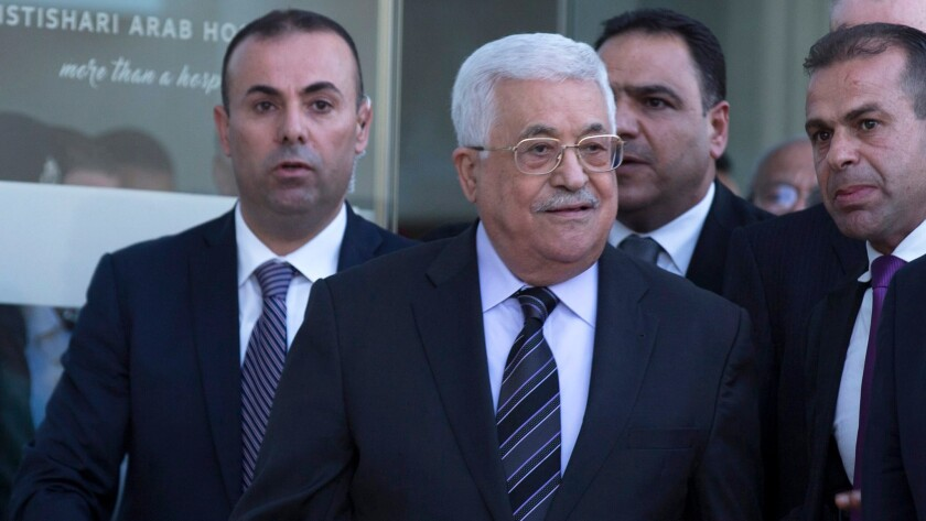 Palestinian Authority President Mahmoud Abbas, center, leaves the Istishari Arab Hospital in Ramallah, West Bank, on Oct. 6, 2016