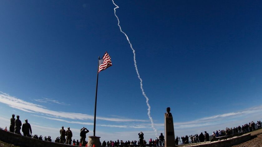 Spectators watch a test flight of an anti-missile interceptor launched from Vandenberg Air Force Base on Jan. 28.