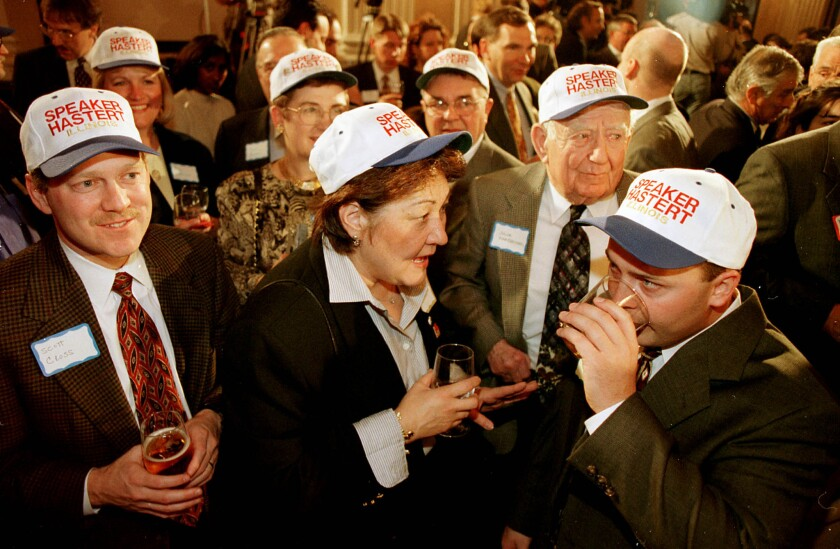 "Scott Cross, left, wears a hat reading ""Speaker Hastert"" as he and others wait on Jan. 5, 1999, for new U.S. House Speaker Dennis Hastert to arrive at a reception at the Cannon Building in Washington, D.C. The event was sponsored by the Illinois State Society. Guests included then-Gov. George Ryan, former Gov. Jim Edgar, Sen. Dick Durbin, D-Ill., and Commerce Secretary Bill Daley."