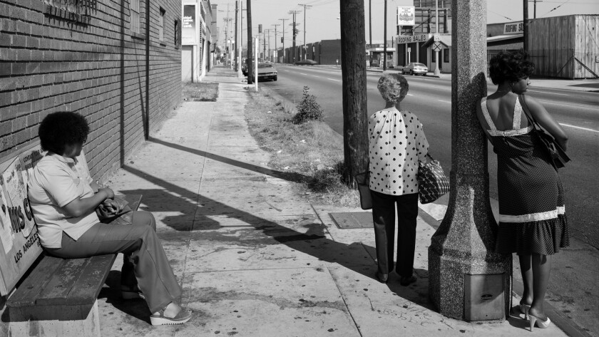 """""""Public Transit Areas #46,"""" from 1979, features people waiting at a bus stop — part of a series that examined these abject municipal spaces."""