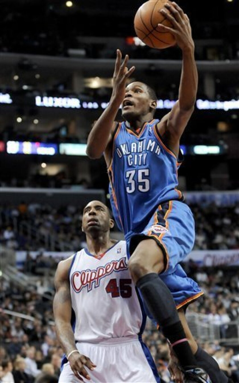 Oklahoma City Thunder forward Kevin Durant (35) drives by Los Angeles Clippers guard Rasual Butler (45) for a basket in the first half of an NBA basketball game, Friday, March 5, 2010, in Los Angeles. (AP Photo/Gus Ruelas)
