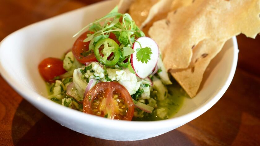 Cusp Dining & Drinks is offering ceviche, one of the happy hour items on their Guilt-Free menu from 4 to 7 p.m. daily.