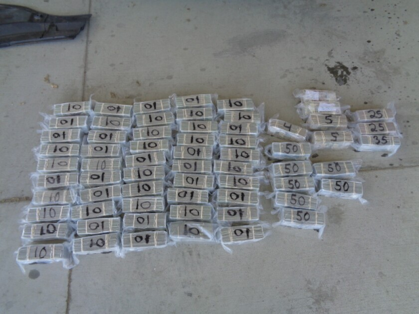 65 bundles of cash, totaling $967,460 in U.S. currency