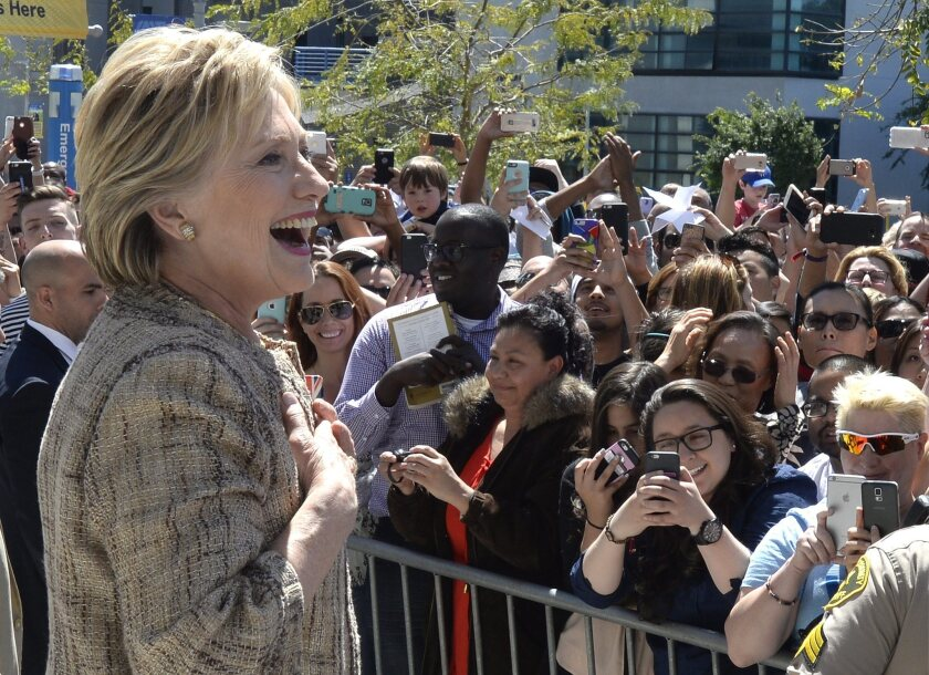 Democratic Presidential candidate Hillary Clinton greets supporters standing in an overflow area outside a rally at Los Angeles Southwest College on Saturday. Clinton was campaigning in advance of the state's June 7 primary.