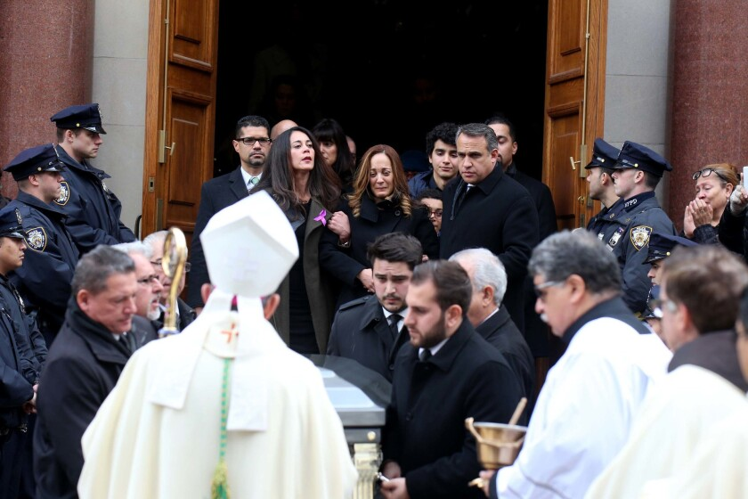Evelyn Peralta, top-center, delivered a eulogy for her husband, Sen. Jose Peralta, Tuesday morning in Queens.