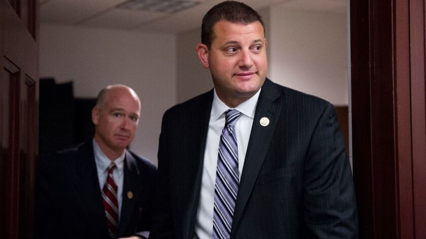 Rep. David Valadao, right, leaving a meeting of House Republicans at the Capitol in October.