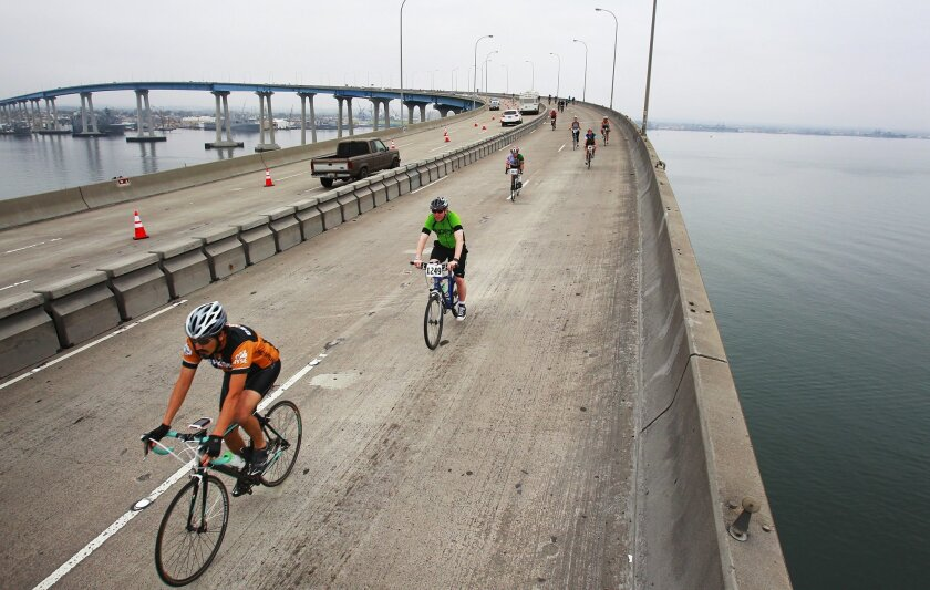Cyclists ride up and over the San Diego-Coronado Bridge during the 25-mile Bike the Bay ride.