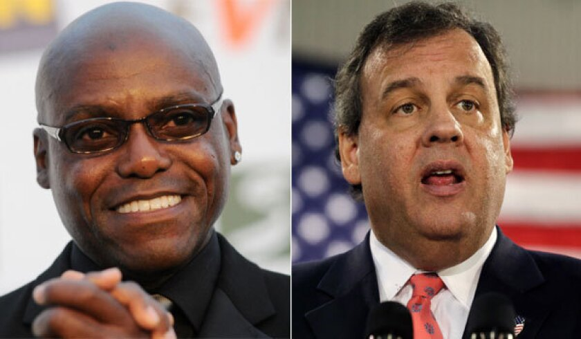 Former Olympian Carl Lewis, left, says New Jersey Gov. Chris Christie tried to use his power to keep him from running for state Senate in 2011.