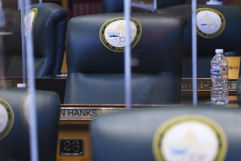 "The desk of Rep. Ron Hanks, R-Penrose, sits empty during second day of the 73rd General Assembly of the Colorado State Legislature, Thursday, Jan. 14, 2021, in Denver. Democrats in Colorado have condemned the Republican lawmaker for joking about lynching before saying a 18th century policy designating a slave as three-fifths of a person ""was not impugning anybody's humanity."" (Hyoung Chang/The Denver Post via AP)"